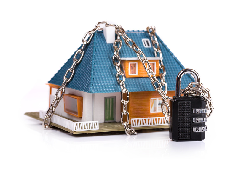 home security concept - chain with padlock around the house